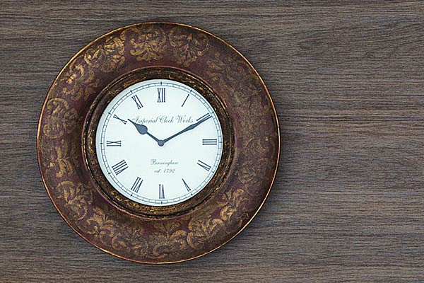 a clock against the porcelain faux wood surface