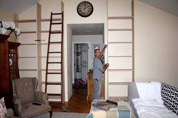 A Wall of Bookshelves: Before from this old house reader remodel Best Built-Ins Before and Afters 2013