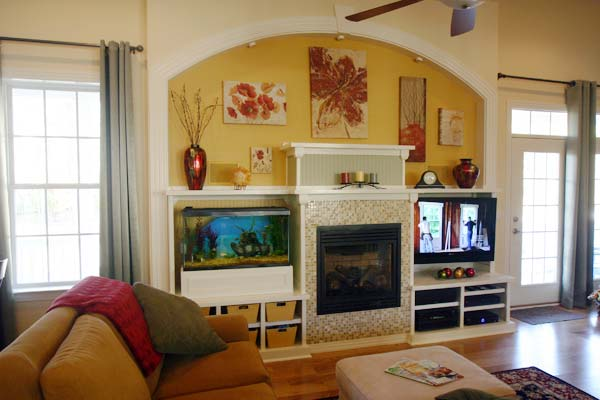 A Grand Fireplace Replaces a Mural: After from this old house reader remodel Best Built-Ins Before and Afters 2013