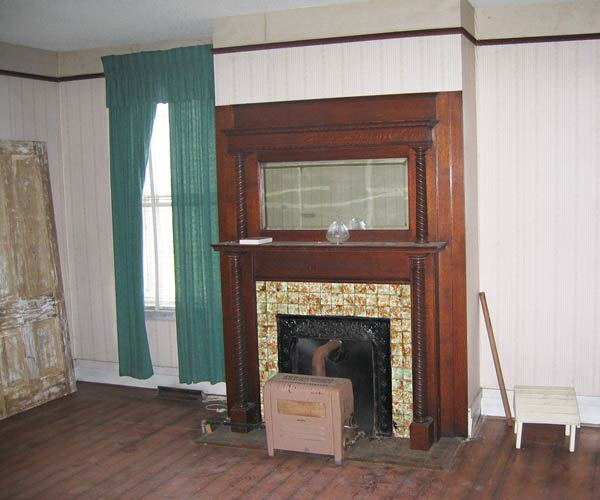 save this old house danville virginia italianate living room fireplace with oak surround and heart pine floors