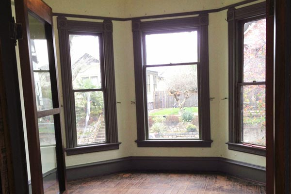 folk victorian cottage living room with bay window, portland oregon, save this old house