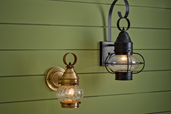 two onion-style porch lanterns on green siding