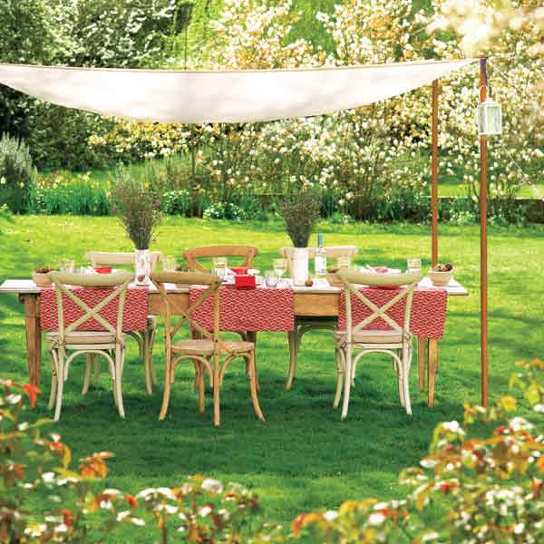 dining table and canopy set up for backyard party