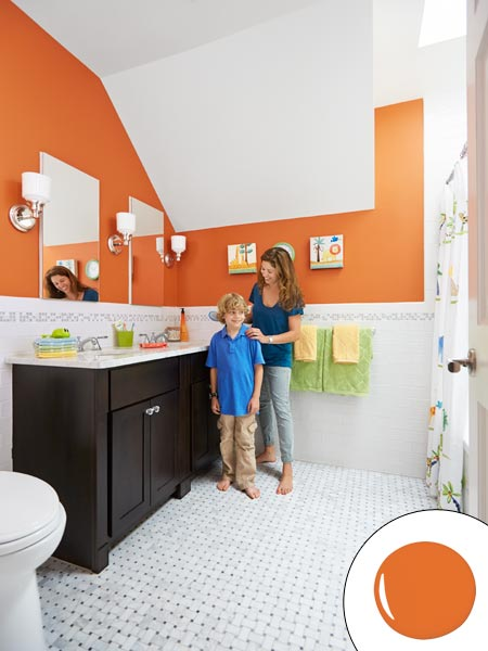 homeowner and son in remodeled orange painted children's bath