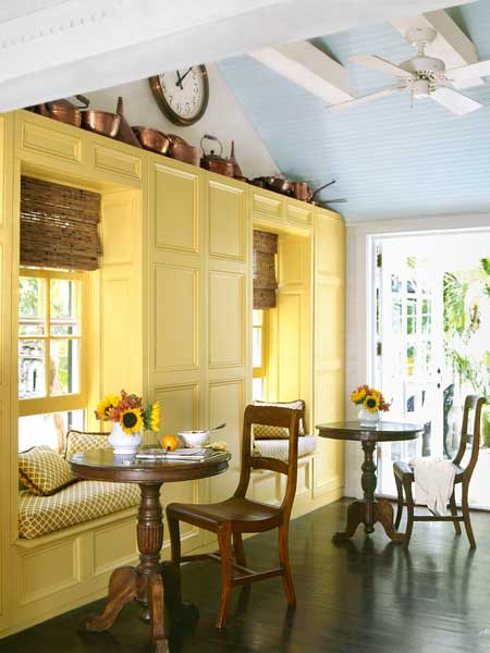 dining area with painted yellow wall cabinets and blue painted ceiling, tricky paint color questions