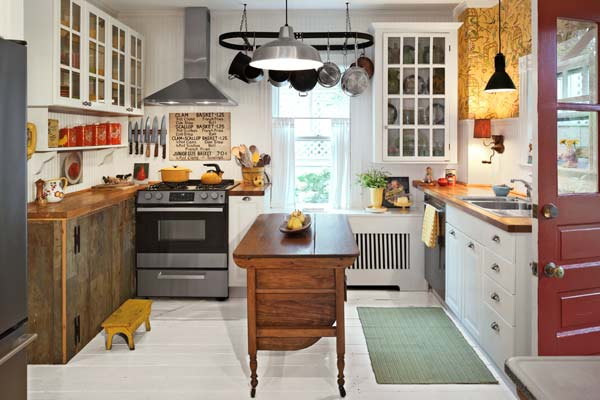 Eclectic Kitchen With Mismatched Cabinets An Accent Wall Of Whimsical