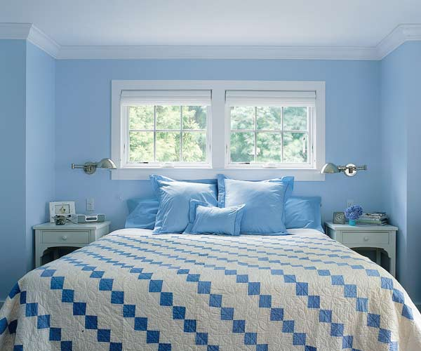 light blue painted cottage style master bedroom with patterned comforter and awning style windows, pantone placid blue color of the month february 2014