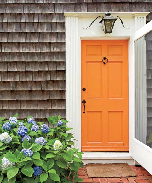 front door painted bright orange, foolproof staging tips from decorators