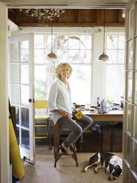 american linoleum floor craftsperson laurie crogan sitting in her studio