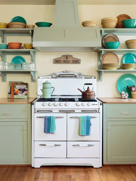 range with custom vent hood to match kitchen cabinets, retro style kitchen with soft green cabinets and salvage apron sink
