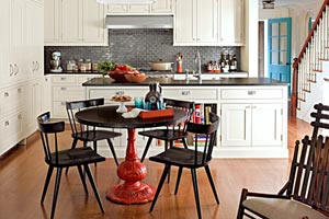 pedestal table, reflective backsplash, and semi-flush mounts are examples of 27 creative kitchen upgrades from This Old House