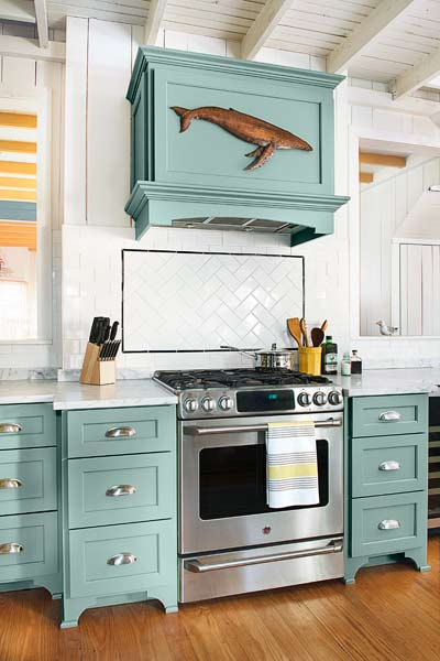 Marble countertops splurge from musty to must see for Beach style kitchen cabinets