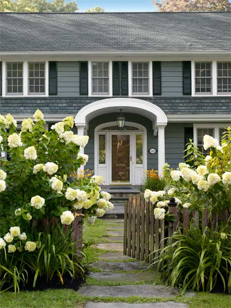 picket fence with lush floral plantings, Dutch Colonial after private and inviting Front Yard Makeover