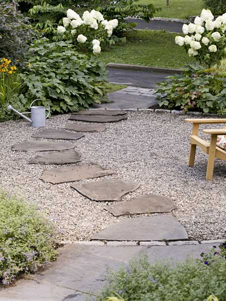 flagstone stepping stones lead to the patio for this dutch colonial 39 s