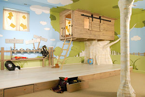 kids' playroom with an indoor treehouse