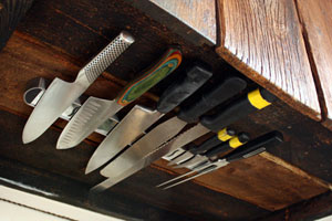 group of knives attached to an under-cabinet knife holder