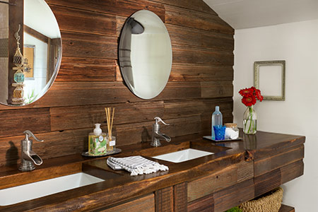 master bathroom with white walls and salvage wood beams for built-in vanity and sloped ceiling covering