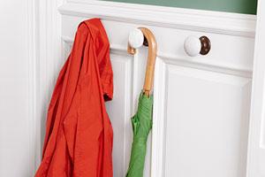 doorknobs repurposed as hooks to hand coats and umbrellas