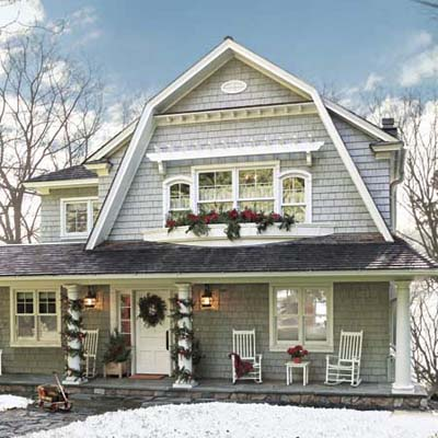 shingle-style cottage exterior decorated for Christmas