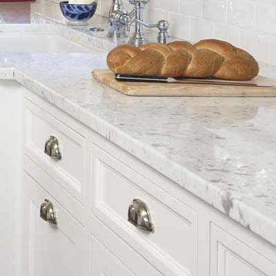 marble counters used in this remodeled shingle-style cottage