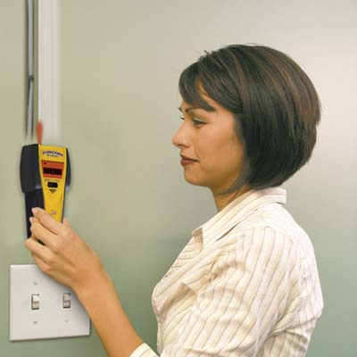 a handheld scanning device for finding studs or joists behind walls, floors and ceilings made by Zircon