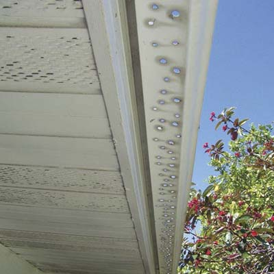 gutter with holes punched out of it