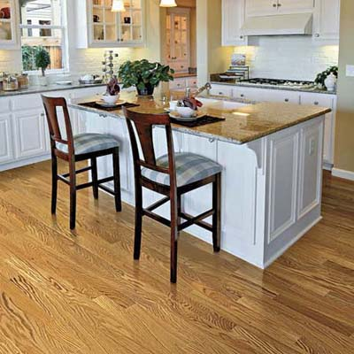 combination of clear-coated red oak floors against painted white cabinets brightens this vintage-look kitchen