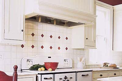 small, red tiles behind a vintage stove