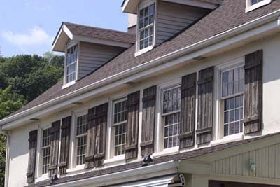 six-over-six double-hung windows in gabled dormers
