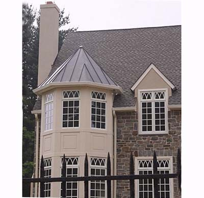 windows in a mcmansion with rhythmic pattern