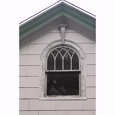a round headed windows with a missing sill