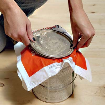 plastic bag placed between a paint can and lid to keep the paint clean and flake-free
