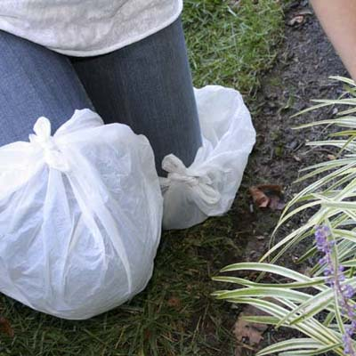 plastic bags wrapped around the knees to protect jeans against dirt