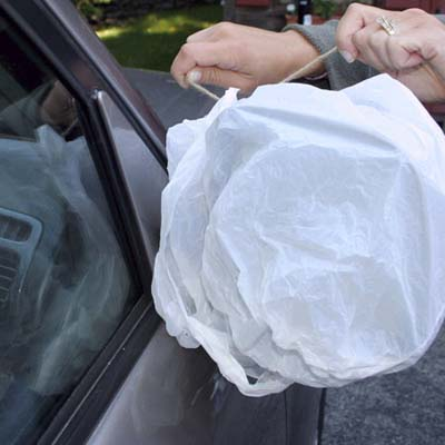 plastic bag wrapped around car mirror to protect against ice