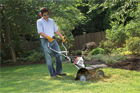 man working on a lawn with a Cultivator made by Stihl