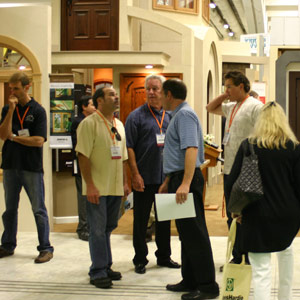 people standing around pacific coast builders conference