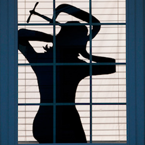 spooky window silhouettes for Halloween of woman with clamped head