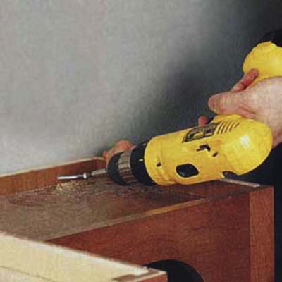 stabilize the entertainment center with a drill