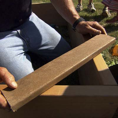 a piece of scrap lumber held at the corners to hold them at a right angle
