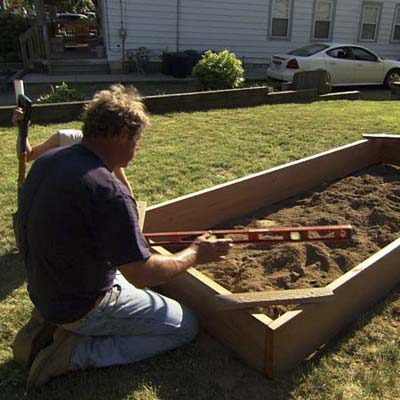 Level the frame | How to Build a Raised Vegetable Garden | This ...