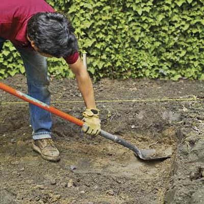 excavate by digging out the topsoil