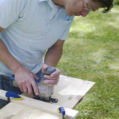 this old house editor mark powers cutting wood to build a pet eating station