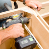 Tom Silva fastening two stock cabinets together