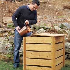 man pouring compost into his compost bin