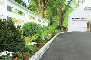 belgian blocks lining the edge of a driveway