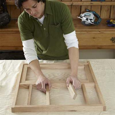 person dry fitting the cut parts together to test the parts for building dog gate