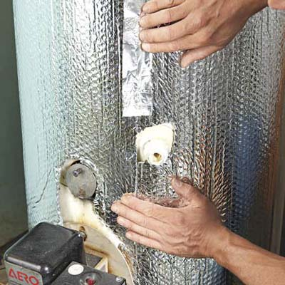 insulating the tank of a water heater with foil-covered bubble wrap