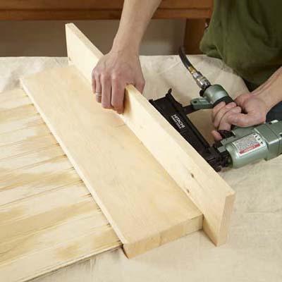 hands nailing a shelf together