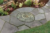 a finished spiral-shaped pebble mosaic