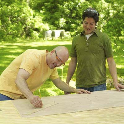 two men preparing materials to make shishkaball game